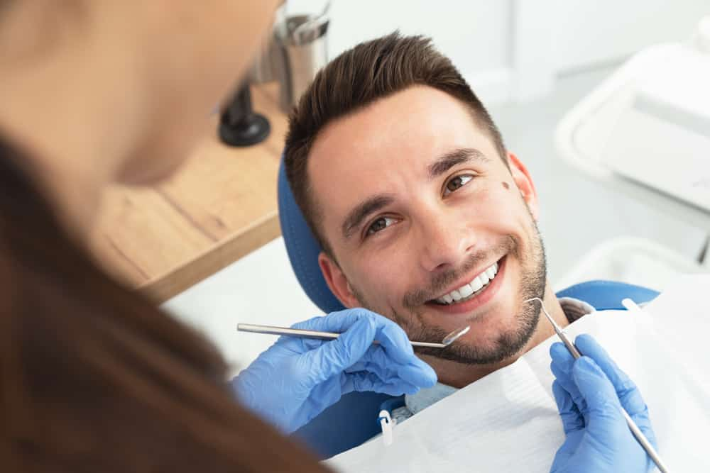 Man,Having,A,Visit,At,The,Dentist's.,Handsome,Patient,Sitting