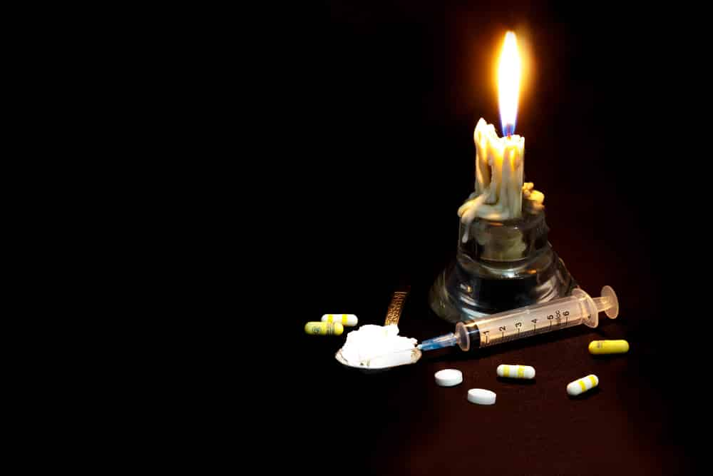 Drugs,Abuse,And,Addiction,Concept.,Candle,,Syringe,,Pill,And,Spoon
