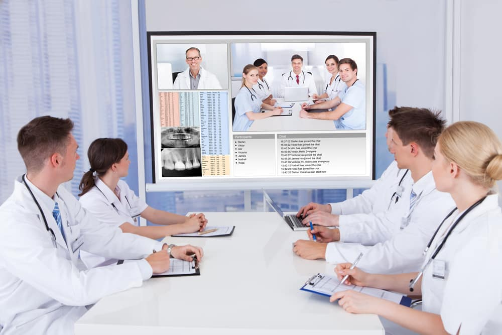 Team,Of,Doctors,Having,Video,Conference,Meeting,In,Hospital