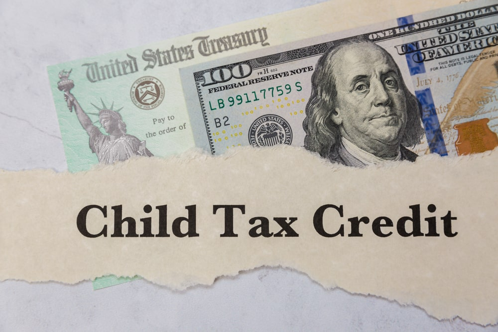 Child,Tax,Credit,-,100,Dollar,Bill,And,Irs,Check