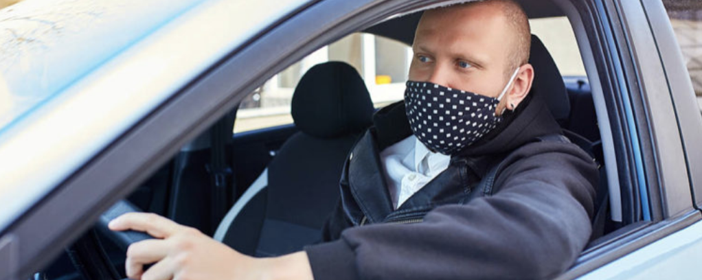 Guy wearing mask while driving