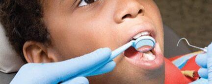 kid at dentists