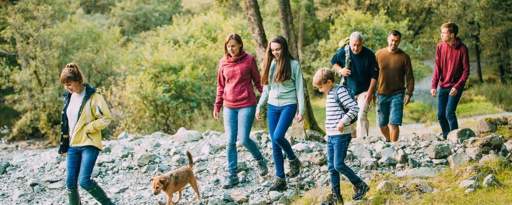 Three,Generation,Family,Are,Hiking,Together,Through,The,Lake,District