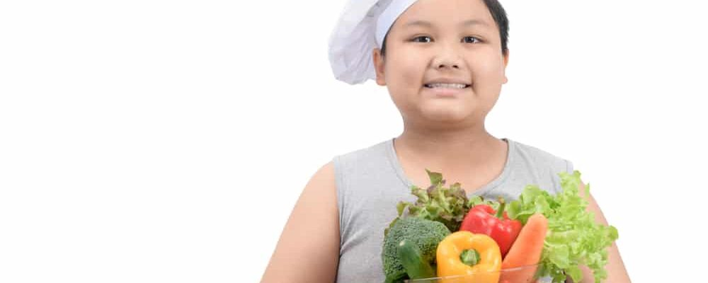 Obese,Boy,Chef,Smaile,And,Holding,Vegetables,In,Bowl,Isolated