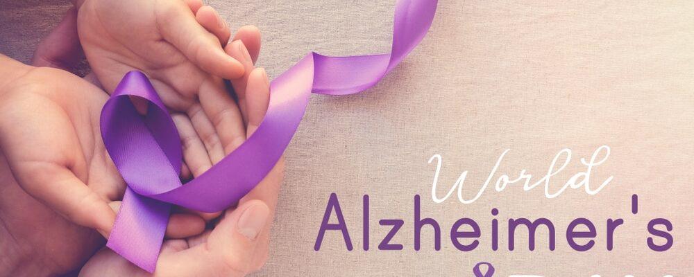 Hands,Holding,Purple,Ribbons,,World,Alzheimer's,Day