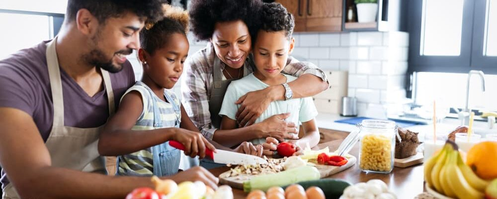Happy,Family,In,The,Kitchen,Having,Fun,And,Cooking,Together.