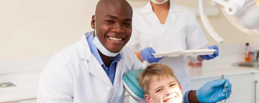 Portrait,Of,Professional,Medical,Team,And,Young,Patient,During,Dental