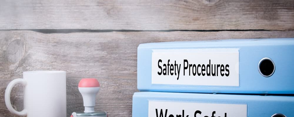 Work,Safety,And,Safety,Procedures.,Two,Binders,On,Desk,In