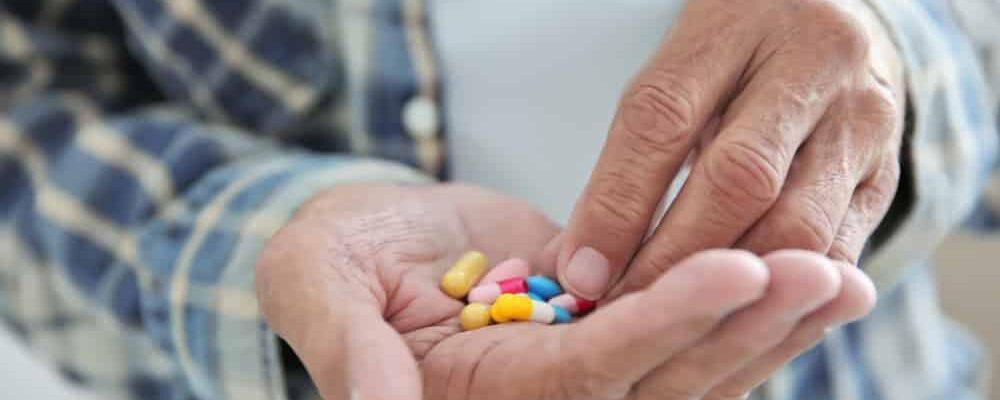 Senior,Man,Taking,Pills,,Closeup