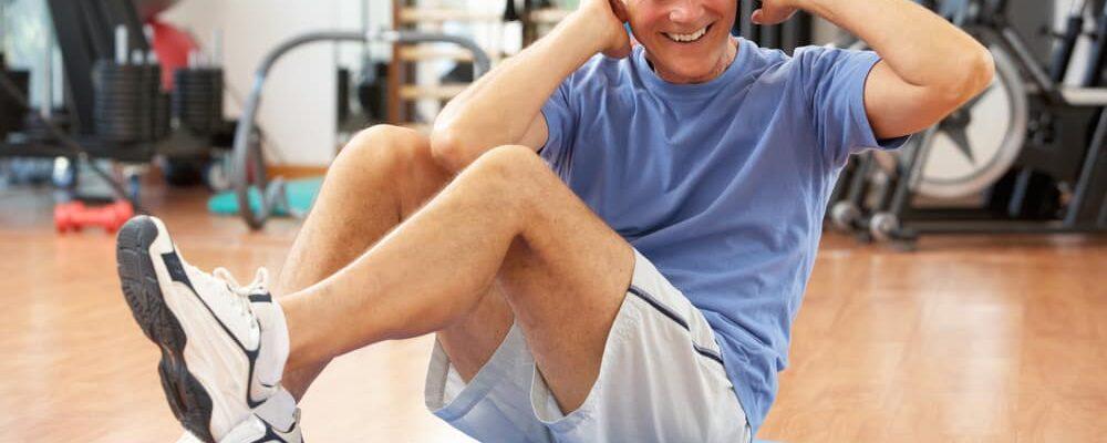 Senior,Man,Doing,Sit,Ups,In,Gym