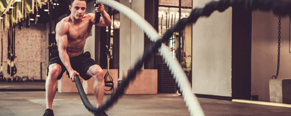 Handsome,Muscular,Man,Is,Doing,Battle,Rope,Exercise,While,Working