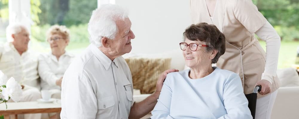 Elder,Man,Visiting,His,Wife,With,Alzheimer's,Disease,At,The