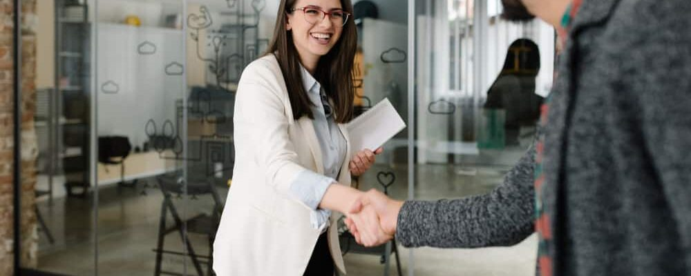 Openly,Greeting,A,Job,Recruiter,With,A,Firm,Handshake
